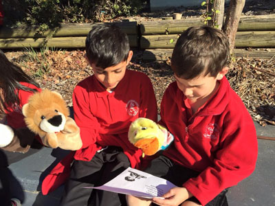 Children Reading with Puppets