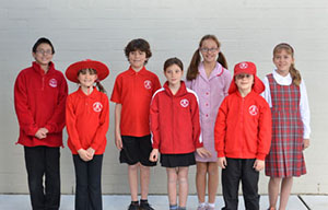 Children dressed in a variety of Chapman Primary Uniform